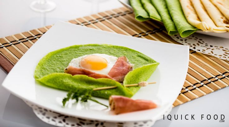 Sunny Side Up Spinach Crepes are a quick and delicious way to start the day. Check out our quick recipe and get your cooking on. #crepes #sunnysideup #prosciutto #spinach