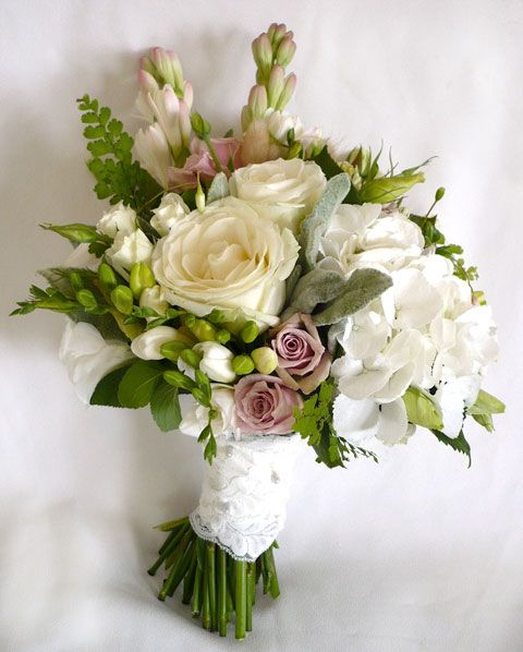 open avalanche roses (ivory), something special roses (dusky pink), Viviane spray  roses (white), white hydrangea, white freesia, tuber rose, white lisianthus, white and pink fuchsia, bunny tails,  lambs ear foliage, maidenhair fern, and mint leaf. Bound in ivory lace ribbon.  *tip: the key to any good 'freshly picked' style bouquet is the foliage herbs and soft garden style green hints