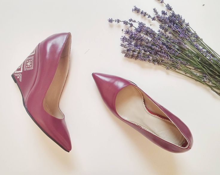 Iutta's embroidered leather shoes in wine red and with a symbol done in cream. Summer flowers complete the fashion photograph. #fashion #photography #leather #shoes #stilettos #iutta #joy #flatly #lavender