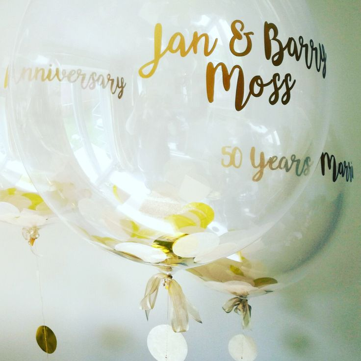 Personalised golden anniversary metallic gold confetti balloons, available from The Feather Balloon Company website