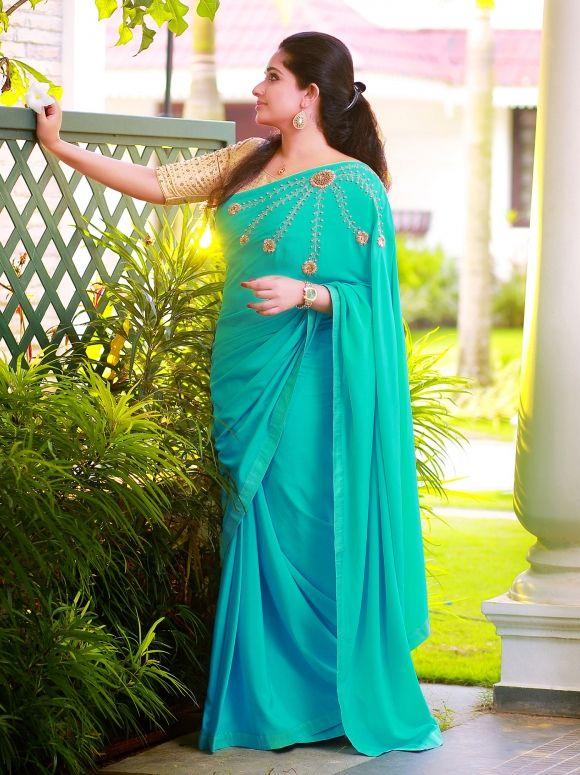 ASTER #Laksyah #soft_crepe #teal_colored #ornate_saree #carved_blossom_design #mirror #beads #zardosi