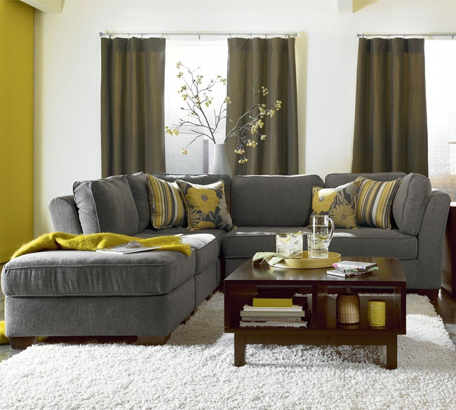 Grey Sectional With Yellow Pillow Arrangement