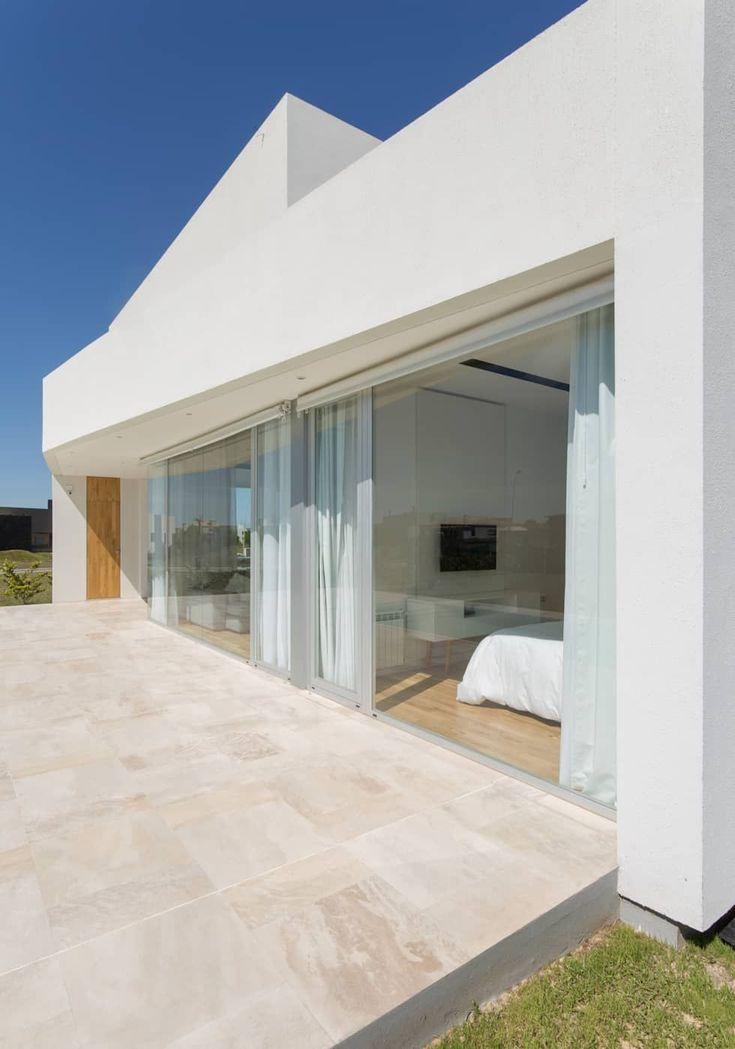 PERSPECTIVA DE FACHADA NORTE: Casas de estilo minimalista por VISMARACORSI ARQUITECTOS #Casasminimalistas