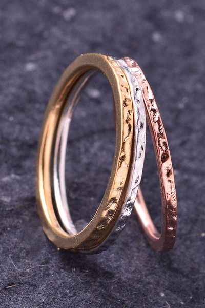 Ring Stack (3)  Hammered silver, gold and rose gold stack of 3 thin rings. We love this stack paired with our rose gold infinity ring. Nickel free.