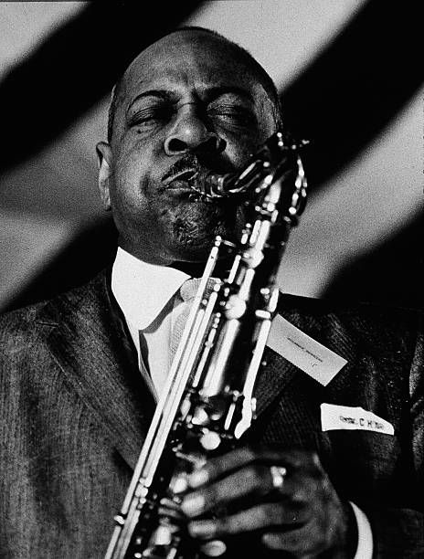 American jazz saxophonist and bandleader Coleman Hawkins (1904 - 1969) plays the tenor saxophone in concert, August 23, 1957.