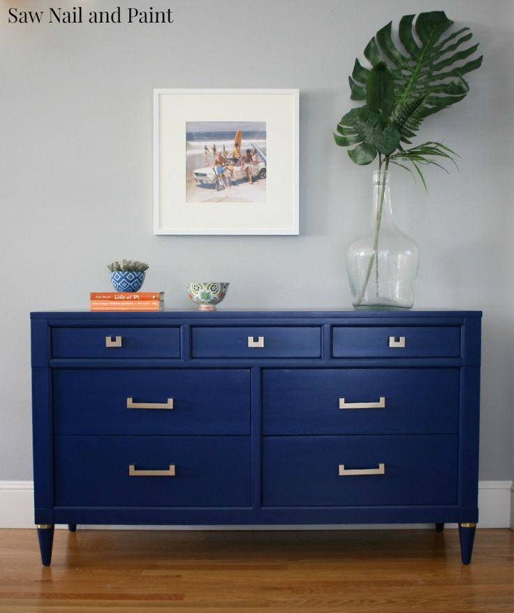 Navy Blue and Gold Dresser This will be an excellent idea for décor and storage in the office. It will store office supplies and files and hold TV and extra décor.