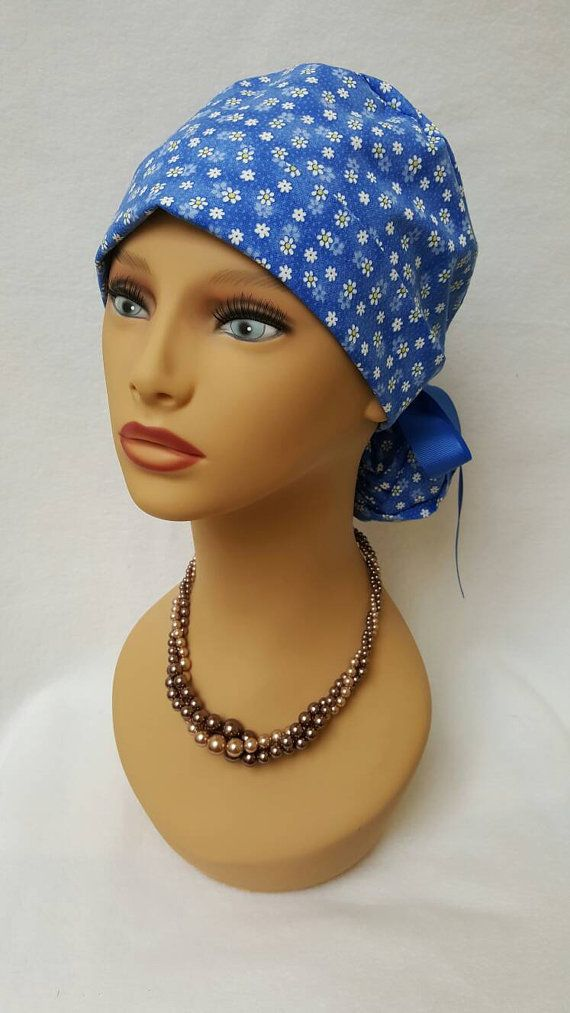 Check out this item in my Etsy shop https://www.etsy.com/listing/483685189/ponytail-scrub-hat-with-ribbon-scrub-hat