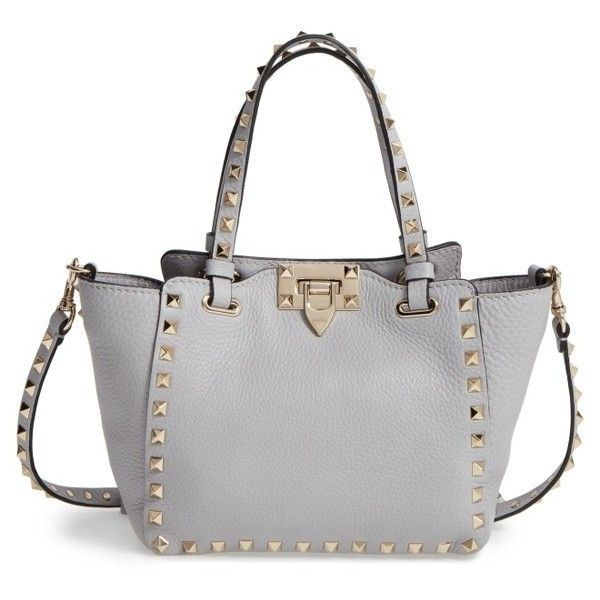 Women's Valentino Rockstud - Mini Alce Leather Tote (86,495 DOP) ❤ liked on Polyvore featuring bags, handbags, tote bags, pastel grey, mini tote, shopper tote, leather purses, grey tote bag and genuine leather tote