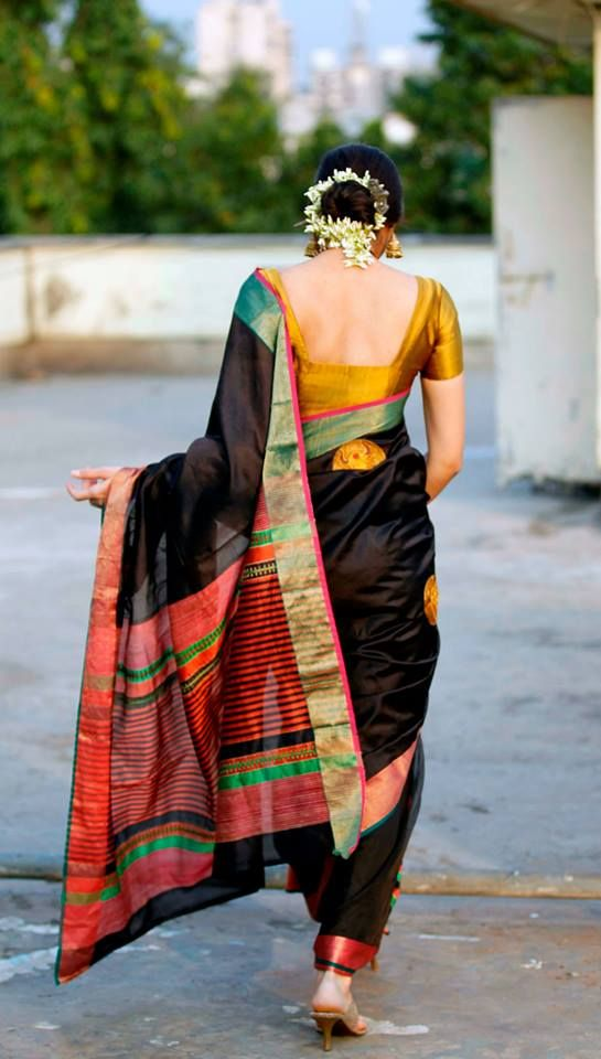 Indian saree - lifting saree pleats, stepping over Godknowswhat, flowers in hair, left arm outstretched to save pallu from trailing on ground.
