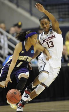Prairie View guard Jeanette Jackson drives around the defense of UConn guard Brianna Banks. 3-23-14