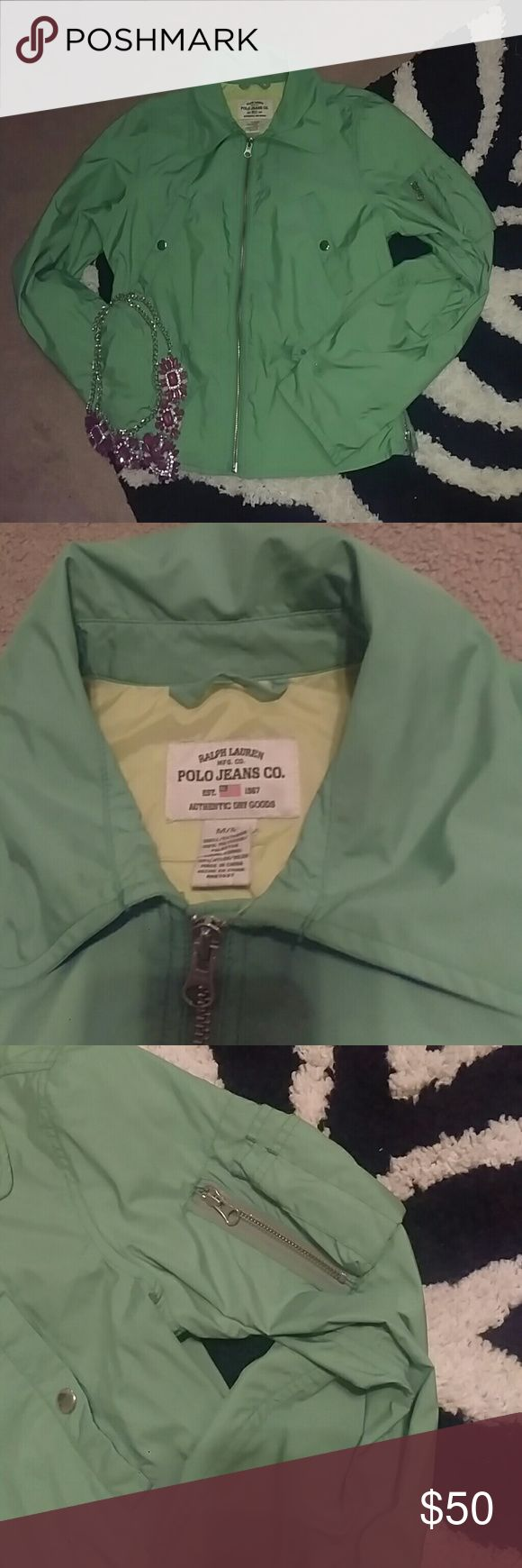 Like New Vintage Ralph Lauren Polo Jeans Co Jacket Like New Vintage Ralph Lauren Polo Jeans Co. Iconic branded style....Jacket  Mint green  Comes with hood that zips! Several decorative zippers on the side.   100% polyester  Sz. M  Please be sure to check out all my other items with prices you won't find anywhere else. Ralph Lauren Jackets & Coats