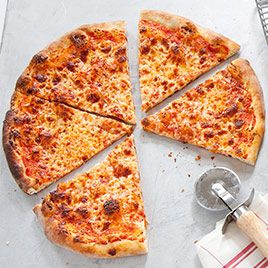 America's Test Kitchen     New York-Style Pizza at Home    Dough        3cups (16 1/2 ounces) bread flour, plus more for work surface (see note)      2teaspoons sugar      1/2teaspoon instant or rapid-rise yeast      1 1/3cups ice water (about 10 1/2 ounces) (see note)      1tablespoon vegetable oil, plus more for work surface      1 1/2teaspoons table salt