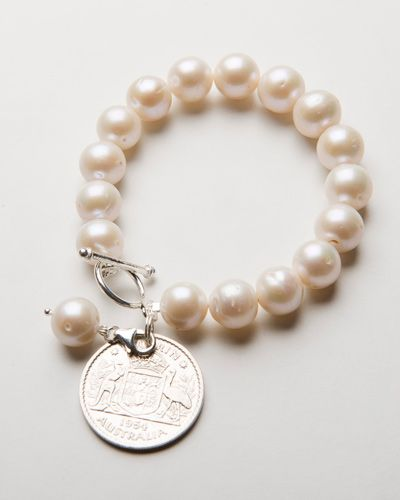 FRESHWATER PEARL COIN $95.00 This beautiful bracelet is handcrafted crafted with stunning, unique freshwater pearls, a sterling silver bar clasp and an original Australian Florin coin charm. This bracelet is the perfect centerpiece to couple with any of our smaller bracelets within our pearl and silver collection. Worn alone or with any of our unique collection this stunning  bracelet is the most gorgeous centerpiece addition to any ladies jewellery collection.