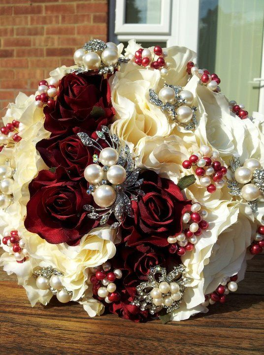 Red and white wedding bouquet.. ♥I think this is gorgeous...in blue of course ~ blue ribbon wrapped around stems for 4th of July wedding theme