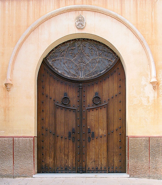 Amazing Spanish door. Can you imagine what's behind it??