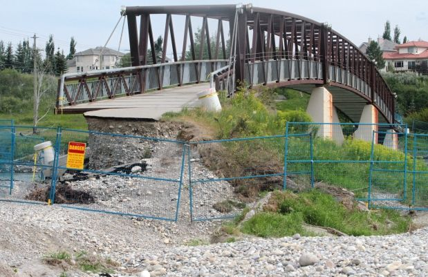 The approach to the pedestrian bridge over the Bow River connecting the northern reaches of Fish Creek Park to Douglasdale Ridge was destroyed by the June flood. Photograph by: Ted Rhodes, Calgary Herald