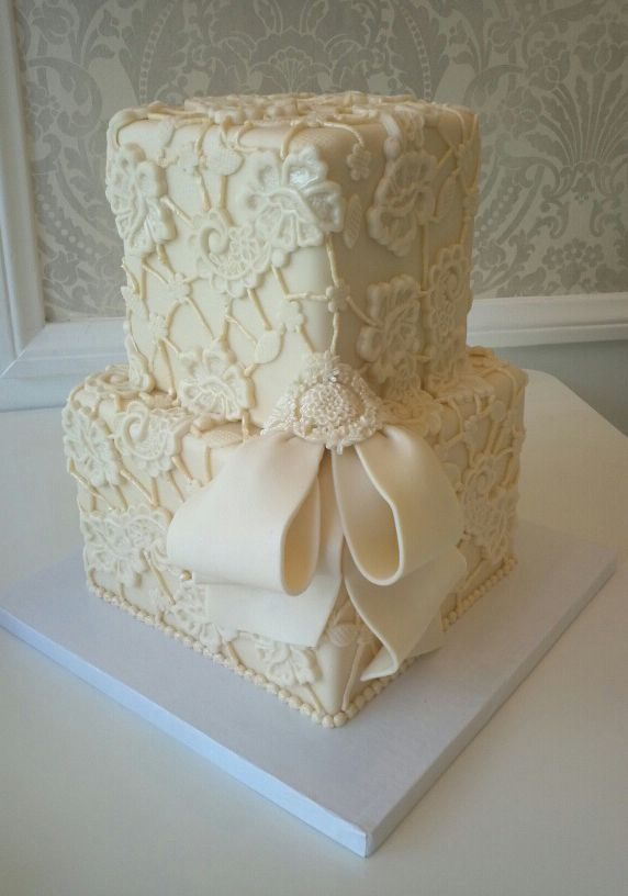 Two-Tiered Cream Lace Patterned Wedding Cake