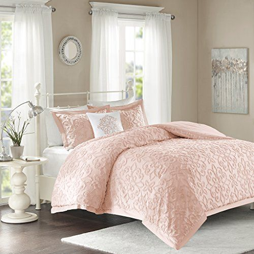 the cotton chenille fabric creates a medallion design on the top of bed and shams in a soft pink color