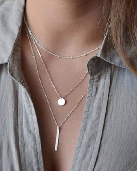 Silver Layered Bar and Disc Necklace Triple silver layered necklace of various lengths. Shortest layer is beaded chain, second layer has a simple disc hanging