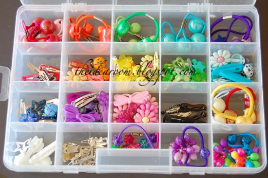 "Use a craft box. A couple of years ago I was fed up with trying to find a matching barette or pony tail holder when I needed it. So I bought a craft organizer box and used it for our hair acessories. We have organized them according mainly to color. Absolutely one of my favorite improvements for making ""girl hair time"" (sometimes not a fun thing at our house) a little more mom friendly."