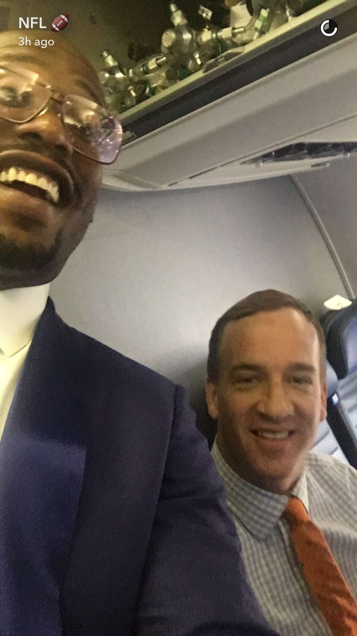 Von Miller and Peyton Manning aboard the Broncos' plane. (via NFL's Snapchat)