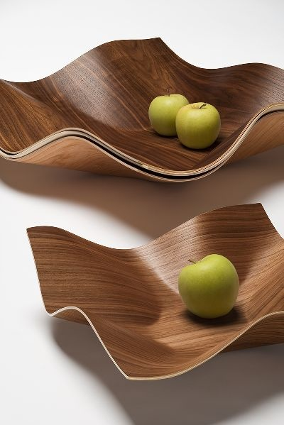 Tuisku bowl is made of walnut plywood. Designed by Petri Vainio. Manufacturer: Showroom Finland.