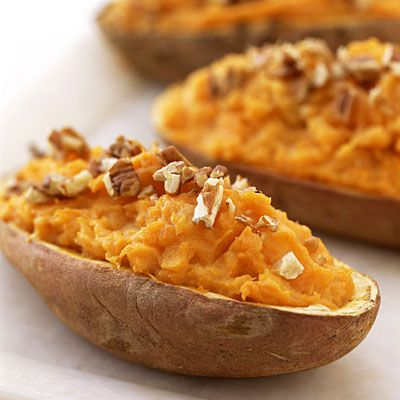 A traditional favorite, we made these twice-baked potatoes healthier by using reduced-fat sour cream and sharp cheddar cheese instead of milk and butter.