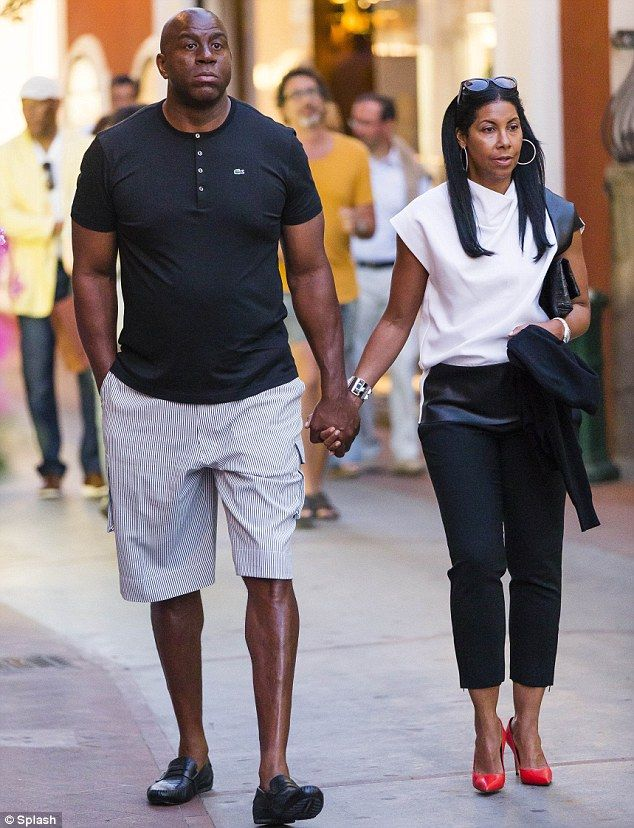 Getaway: Magic Johnson walked hand-in-hand with his wife Earlitha Kelly as Samuel L. Jackson trailed behind them in Capri, Italy, on Tuesday