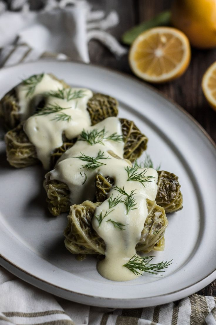 Greek stuffed cabbage rolls with avgolemono sauce