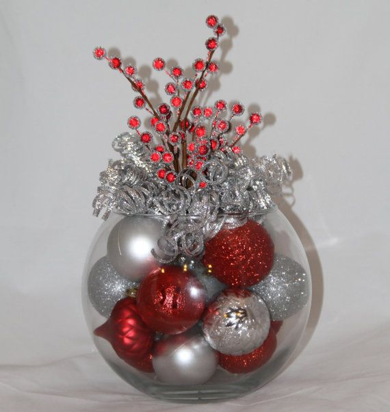 Christmas Centerpiece - Red and Silver Holiday Decoration - Hostess Gift - Christmas Event Centerpiece - Corporate Christmas Party  Want a beautiful and unique centerpiece for your christmas table? We offer unique, handmade christmas decor to compliment your personal christmas scheme. Looks great from all angles.  This centerpiece is a gorgeous combination of sparkling silver and vibrant red ornaments topped with a beautiful assorted of colorful holiday ribbons and beads.  Approximate size…