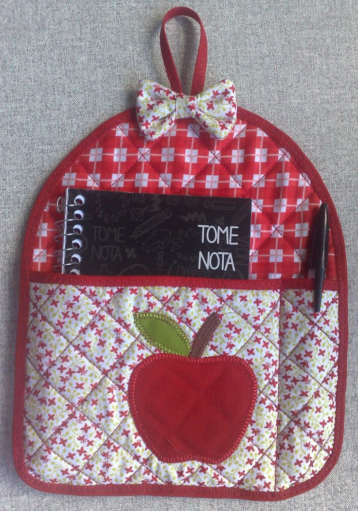 Great idea for the kitchen or sewing room. Wall notebook and pen holder.