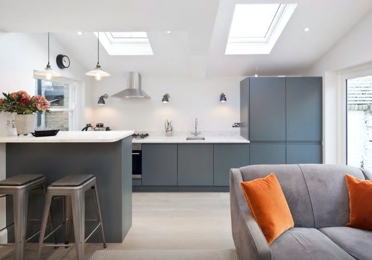 Graphite dark grey handleless kitchen in a contemporary London apartment. Open plan living, kitchen in a matt finish by Kitchen & Bedroom Store.