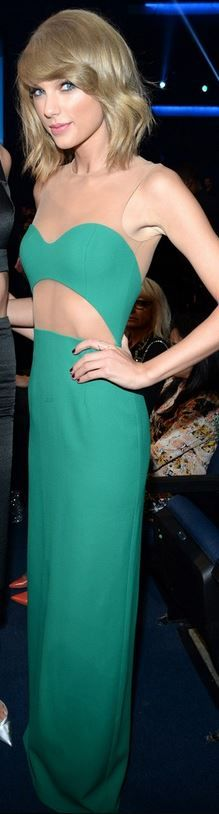 Who made Taylor Swift's green cut out gown that she wore in Los Angeles on November 23, 2014?