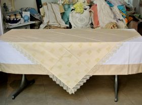 """Tablecloth in fabric part of the series """"Ori di Taranto"""" in cotton and lurex. The lace is in tulle with gold embroidery. #madeinitaly #artigianato #tavola #tablecloth"""