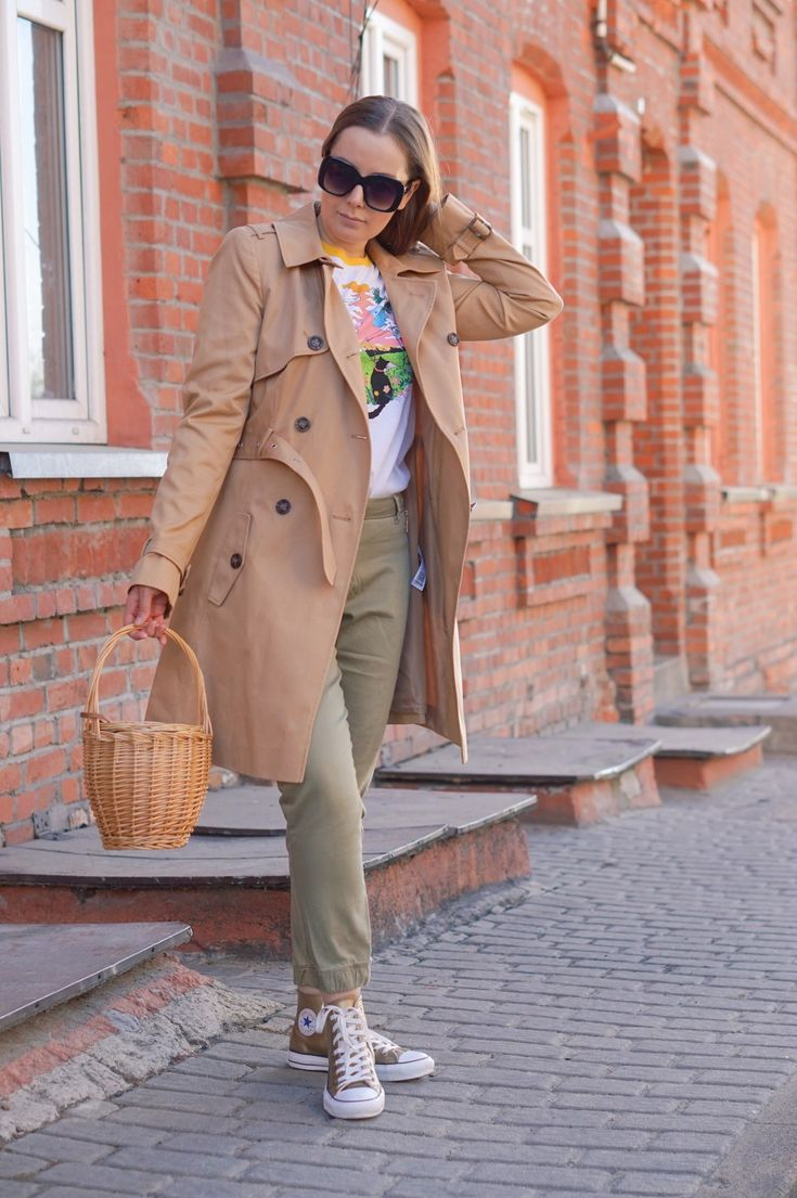 Classic Trench Coat, PS by Paul Smith Sign Posted T-Shirt with a black cat, Oversized Cats Eye Sunglasses, Basket Bag and gold high Converse shoes