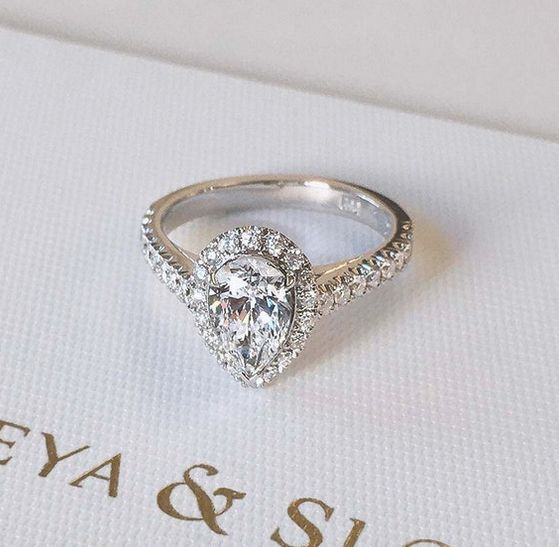 Naveya & Sloane bespoke pear cut diamond centre stone, with a claw set halo and diamond band. Crafted in platinum.