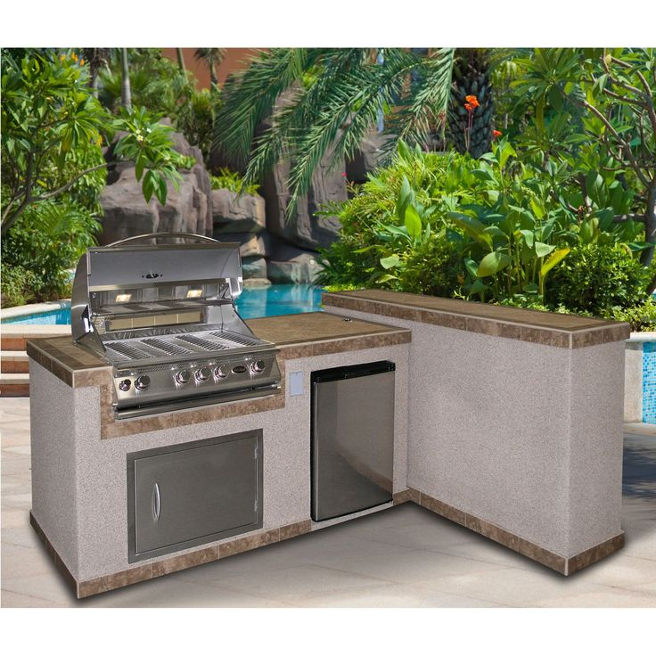 This breathtaking barbecue island includes a 60,000 BTU 4-Burner Stainless Steel Gas Barbecue Grill, 27-inch  Stainless Steel Access Door, 4.6 cu. ft. Built-In Stainless Steel BBQ Refrigerator, electrical outlet and an umbrella hole.