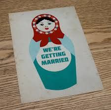 russian doll on invites with names and date in middle? then reply slip library card?