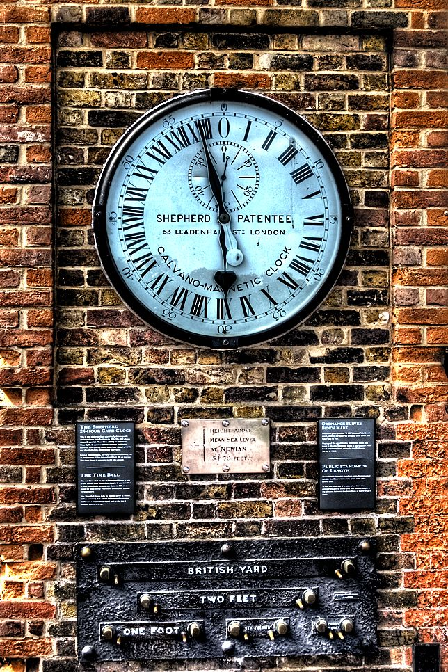 The Shepherd Gate 24-Hour Clock, Greenwich, London. The first to show Greenwich Mean Time to the public, public standards of length are presented below it.