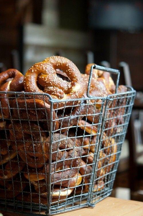 Wire basket filled with fresh soft pretzels.