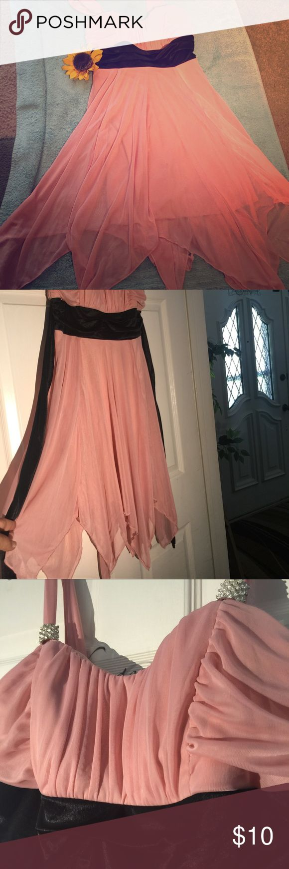 Dress This cute dress can be used out on the town, at a wedding, prom or formal dinner. It's a soft pink ( like mauve color pink) with black . accent with fake diamond like gems on the straps, hidden zipper on back and ties too. Clean no stains 🚭🏡 medium junior dress Pompous Girly  Dresses Prom
