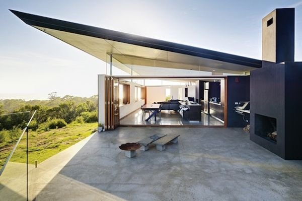 """Titled """"The Southern House"""" and known as """"Brow of The Hill"""", Fergus Scott Architects hit the nail on the head with this curved metal structure that incorporates insane views of the Aussie coast. The upwardly slanted roof adds appeal, while clerestory windows provide plenty of natural sunlight from the water's edge."""
