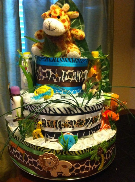 Safari Diaper Cake is way cute. I really like the way the layers look on this cake. Going to give this diaper cake style a whirl.