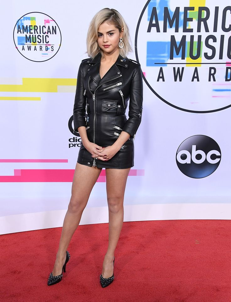 Selena Gomez showed off her new, edgy blonde 'do in a leather mini dress from Coach and Roberto Coin jewelry. (Getty)  via @AOL_Lifestyle Read more: https://www.aol.com/article/lifestyle/2017/11/20/2017-american-music-awards-all-the-prettiest-looks-of-the-night/23283303/?a_dgi=aolshare_pinterest#fullscreen
