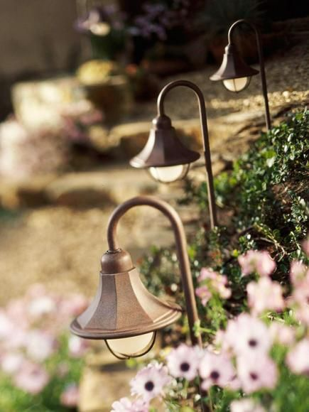 I love little lanterns because I think it gives your walkway a lot of character.  You can find lots of outdoor lighting at Home Deport or Lowes and you can get the look without spending a lot of money.