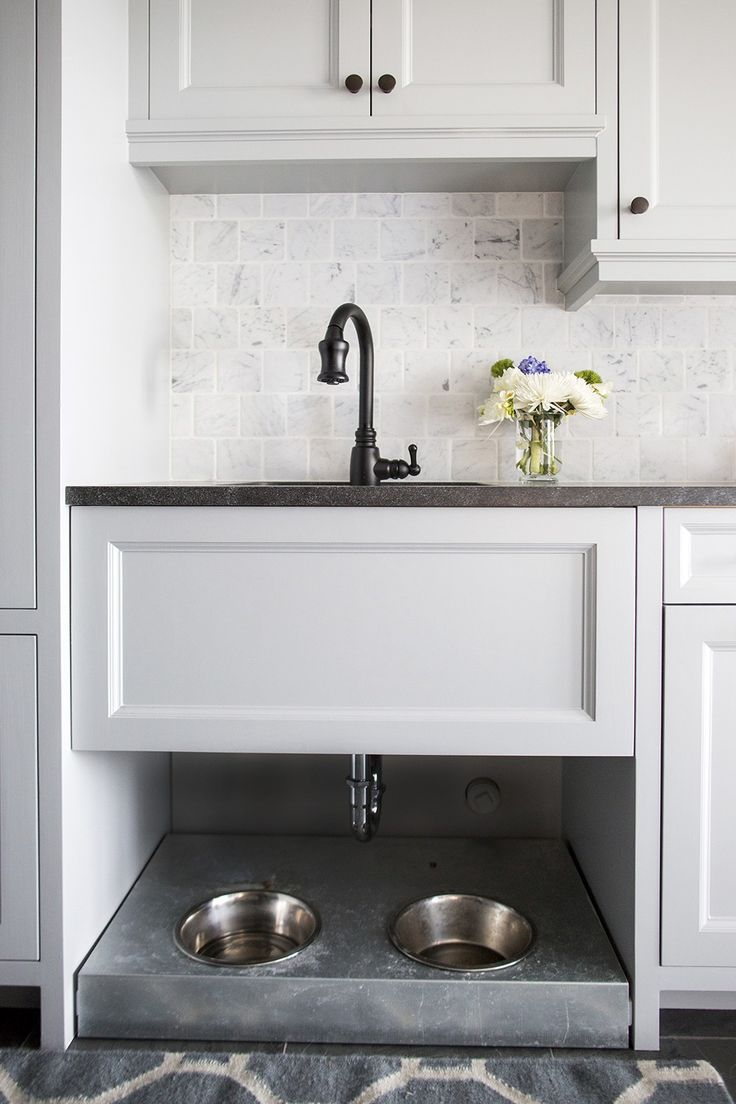 Dog bowls under mudroom sink-Lakeside Residence | Martha O'Hara Interiors