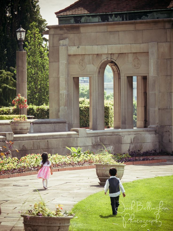 Kids running at a wedding in Oakes Garden Theatre in Niagara Falls. It's such a beautiful spot for a wedding with Niagara Falls in the backdrop. #JoshBellinghamPhotography