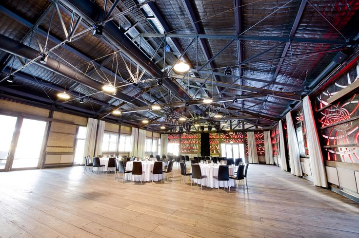 Many original features have survived the shed's recent history, such as the original roof trusses, the chamfer timber posts, the old wharf timber floor boards. Showtime Events Centre, South Wharf.