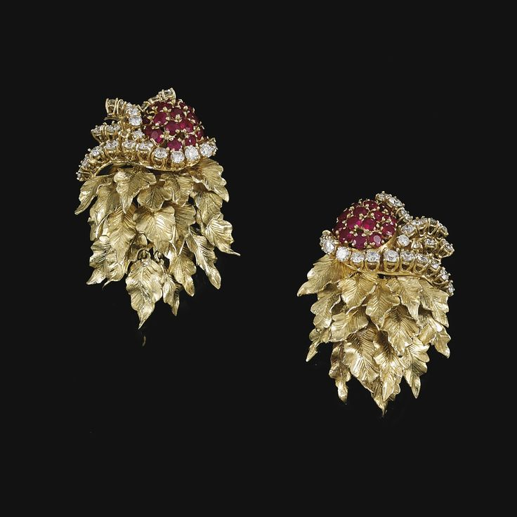 PAIR OF RUBY AND DIAMOND EAR CLIPS, RENÉ BOIVIN, 1940S Each surmount set with circular-cut rubies and curving lines of similarly-cut diamonds, suspending a cascading fringe of gold leaf motifs, each with French assay and maker's marks for René Boivin, fitted case stamped René Boivin. Sold in Geneva 2013 for 22,500 CHF