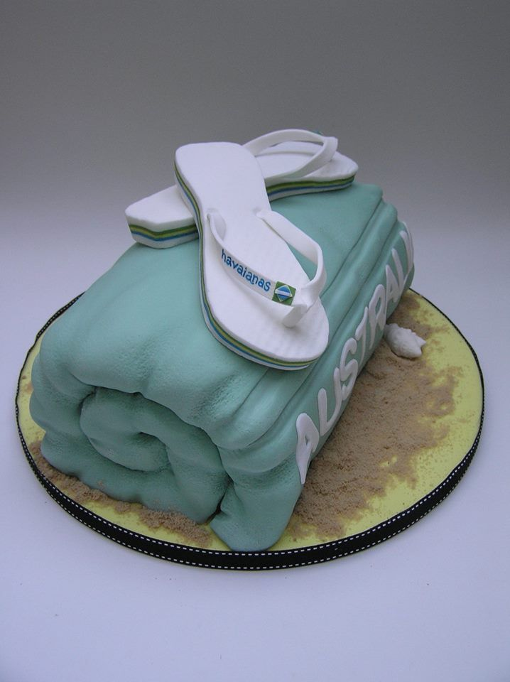 www.cakecoachonline.com -sharing...Beach towel cake with edible flip flops - by Scrum Diddly cakes